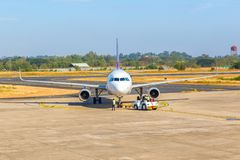 Airplane at airport terminal gate ready for takeoff stock photography