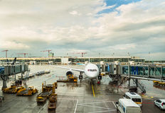 Airplane and airport vehicles Stock Image