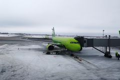 Airplane, airport workers, transfer from the airplane to the terminal building. stock image