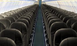 Airplane aisle with row of seats. Image of airplane aisle with row of seats royalty free stock photography