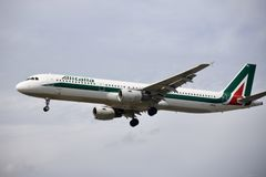 A airplane of Alitalia Italian Air Company airlines flying in the sky. A airplane of Alitalia airlines flying in the sky,  Italian Air Company, airbus A321 royalty free stock image