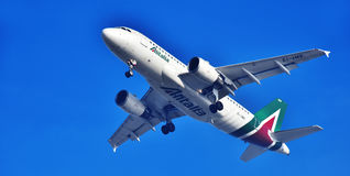Airplane of Alitalia approaching the airport. ROME, ITALY - JUNE 14, 2017: Societa Aerea Italiana or Alitalia the flag carrier of Italy with head office in Royalty Free Stock Images