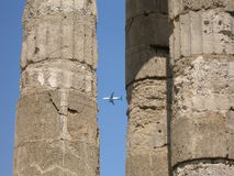 Airplane and ancient city Royalty Free Stock Photo