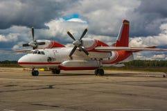 Airplane, Antonov 32, plane on airdrome. Airplane, Antonov 32, aircraft on airdrome under clouded sky Stock Photo