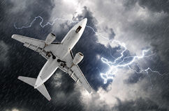 Airplane approach at the airport landing in bad weather storm hurricane rain llightning strike Stock Photo