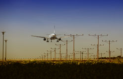 Airplane approaching. For Touchdown at sunset Royalty Free Stock Photography