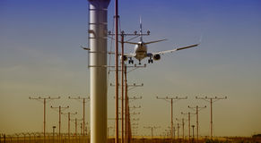 Airplane approaching. For Touchdown at sunset Royalty Free Stock Photos