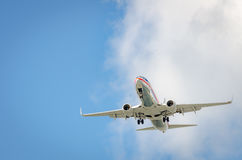 Airplane approaching the airport and landing in Miami Stock Photo