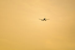 Airplane approaching an airport. For landing at sunset Stock Images