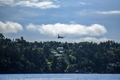 Airplane approaching landing, Bergen Airport, Norway. Stock Images