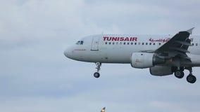 Airplane approaching before landing. FRANKFURT AM MAIN, GERMANY - SEPTEMBER 4, 2015: Tunisair Airbus 320 TS-IML approaching before landing at runway 25L stock footage
