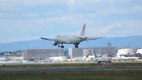 Airplane approaching before landing. FRANKFURT AM MAIN, GERMANY - SEPTEMBER 4, 2015: Tunisair Airbus 320 TS-IML approaching before landing at runway 25L stock video