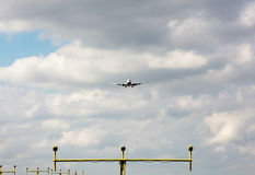 Airplane approaching landing lights Stock Photos