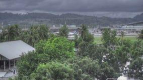 Airplane approaching Phuket airport at rain stock footage