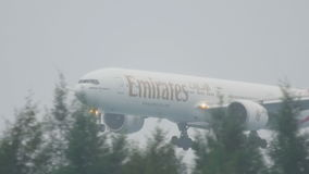 Airplane approaching Phuket airport at rain stock video footage