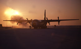 Airplane in arctic. An aircraft in the Canadian high arctic waits for passengers and freight stock images