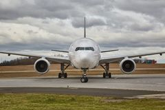 Airliner front view. Airplane arriving at an airport, front view Stock Photography
