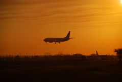 Airplane arriving at dawn Stock Image