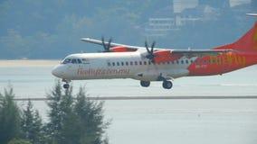 Airplane ATR 72-500 landing. PHUKET, THAILAND - NOVEMBER 26, 2016: Firefly Airline ATR 72-500 9M-FYF landing on the runway of Phuket International Airport, slow stock video