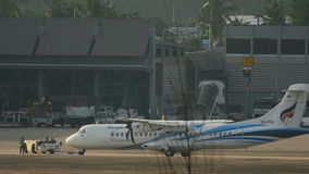 Airplane ATR-72 towing before departure stock footage