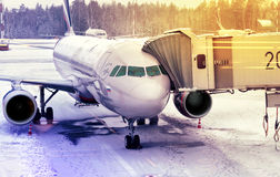 Airplane attached to passenger boarding  bridge Stock Image
