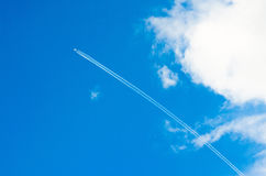Airplane aviation airport contrail the clouds.  Stock Photo
