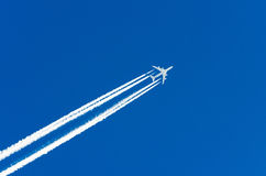 Airplane aviation airport contrail the clouds. Airplane aviation airport contrail  clouds Stock Photography