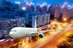 The airplane away from the city. Abstract background stock image