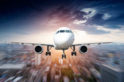 The airplane away from the city Royalty Free Stock Photography