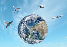 Airplane away from the earth. Royalty Free Stock Images