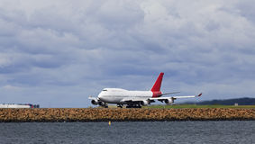 Airplane B747 land sea panorama Royalty Free Stock Images