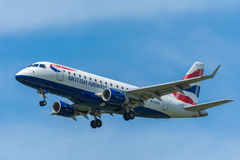 Airplane BA CityFlyer G-LCYG Embraer ERJ-170 is flying to the runway. Stock Photos