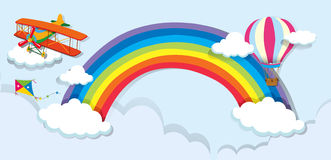 Airplane and balloon over the rainbow Royalty Free Stock Image