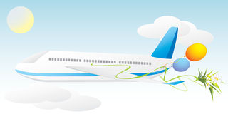 Airplane with balls and bouquet of chamomiles Stock Photography