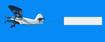 Airplane with a banner Royalty Free Stock Photo