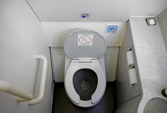 Airplane Bathroom Toilet. The cramped and dirty bathroom of a commercial airliner Stock Images