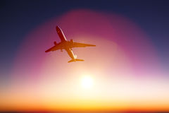 Airplane with beautiful orange sunset background Royalty Free Stock Photography