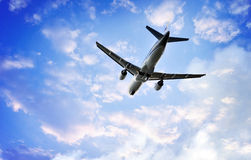 Airplane in the beautiful sunset sky Stock Images