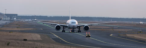 Airplane beeing towed on a runway Stock Photo