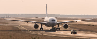Airplane beeing towed on a runway Royalty Free Stock Photo