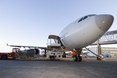 Airplane being loaded. With cargo Royalty Free Stock Photos