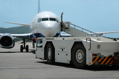 Airplane Is Being Serviced. In Airport Stock Image