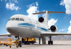 Airplane is being serviced Royalty Free Stock Image