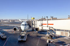 Airplane Being Serviced at Airport Gate Royalty Free Stock Photo