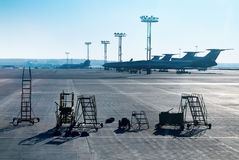 Airplane is being serviced by the ground crew. Aeroport Stock Images