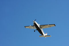 Airplane belly in blue sky