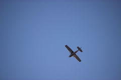 Airplane in the ble sky Royalty Free Stock Photo