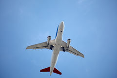 Airplane in blue sky Stock Photo