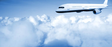 Airplane on blue sky Royalty Free Stock Images