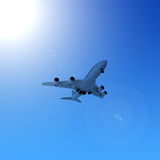 Airplane in the blue sky Royalty Free Stock Photography